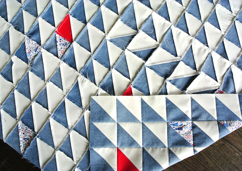 Quilting with denim - tricks, tips and lots of quilt inspiration. This Gee's Bend inspired quilt can be made using this FREE half square triangle tutorial!