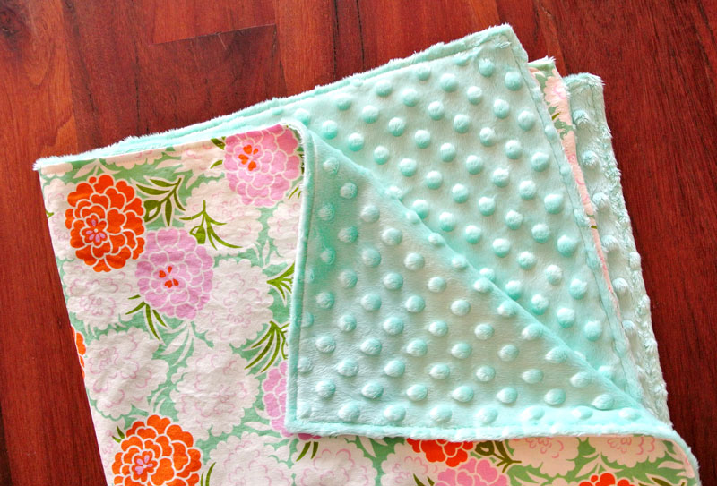 Make a soft, minky baby blanket in 30 minutes! This simple pattern uses only basic supplies and a beginner's knowledge of sewing | Suzy Quilts - https://suzyquilts.com/how-to-make-a-minky-baby-blanket