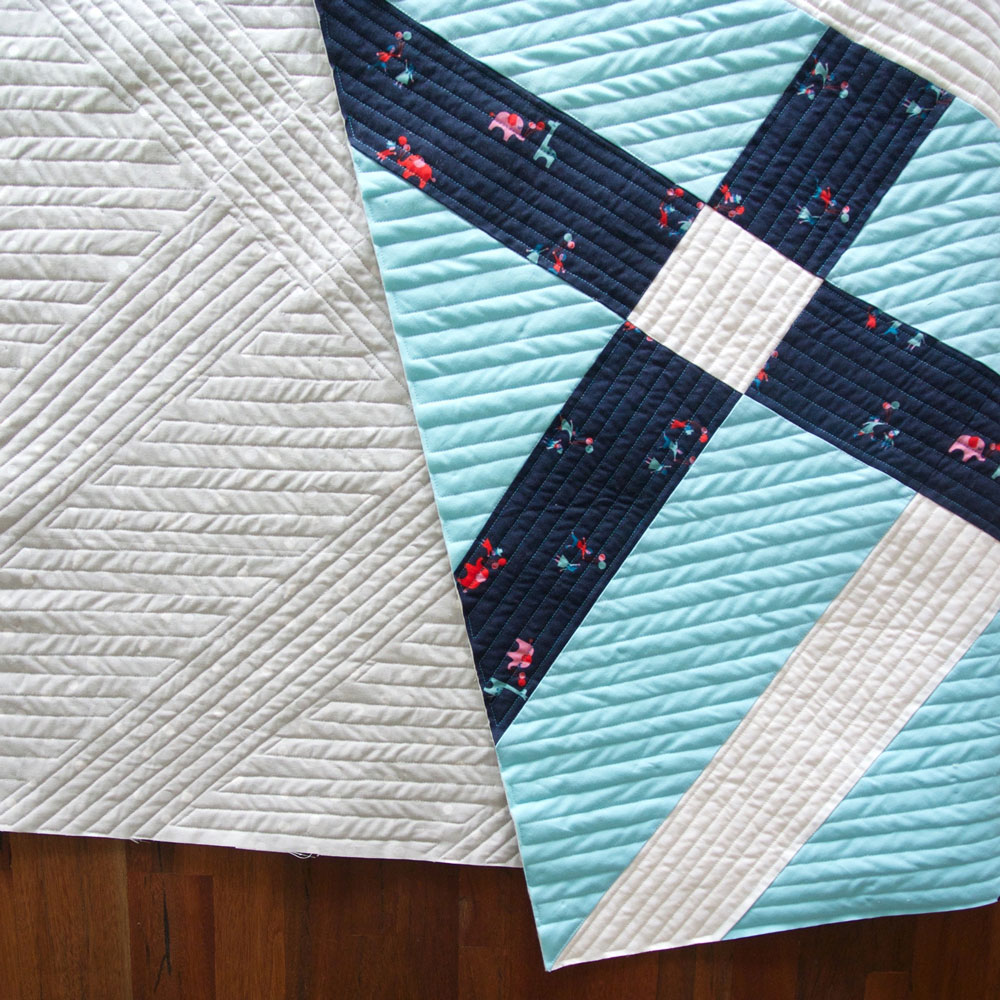Learn the 6 easy steps for perfect straight line machine quilting. This Fishing Net quilt is an example of why you should sew in the same direction – to avoid wave-like pulling