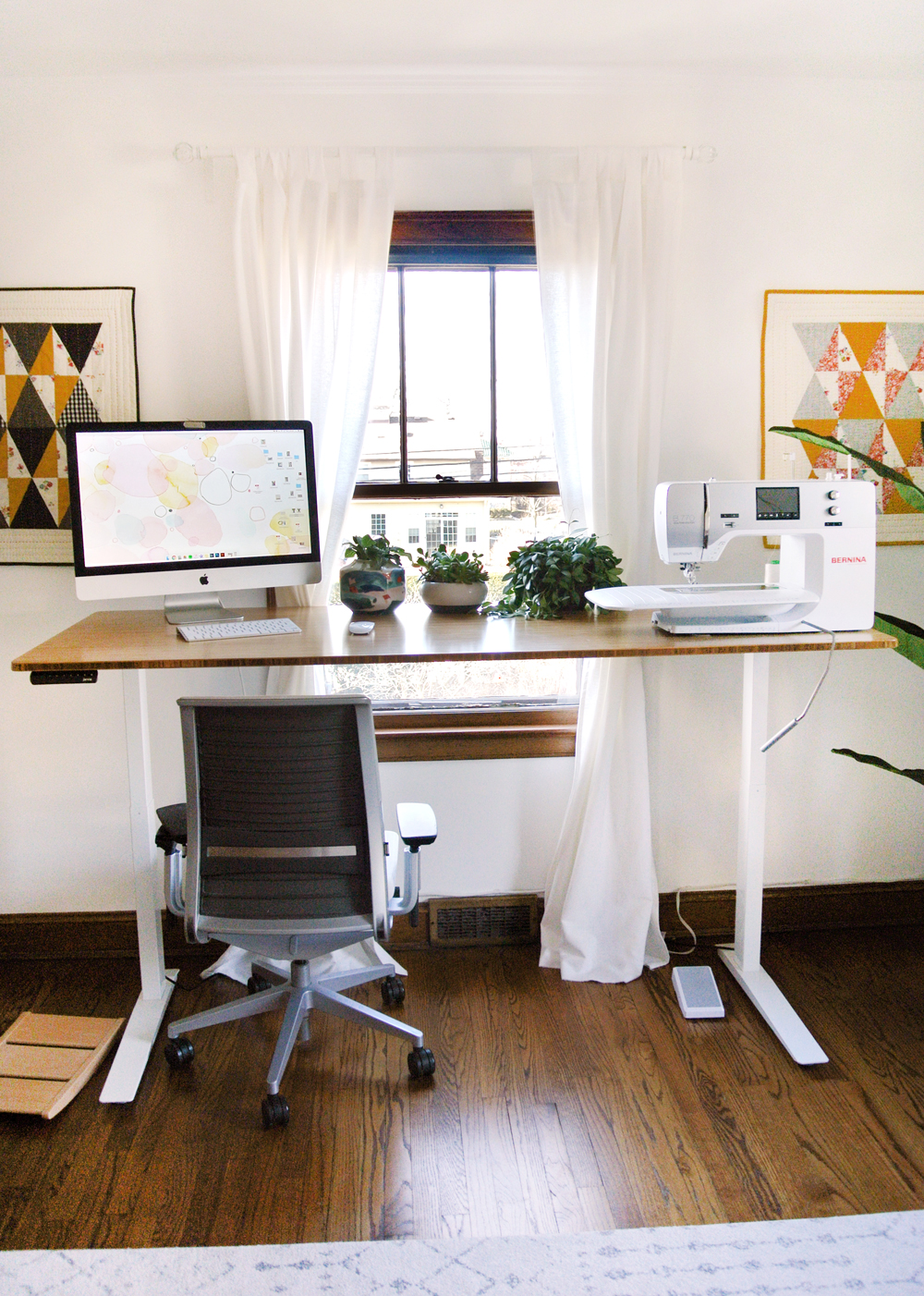 A tour of the Suzy Quilts studio with the New and Improved Standing Desk! Standing Desk Sewing Studio by Suzy Quilts https://suzyquilts.com/standing-desk-sewing-studio