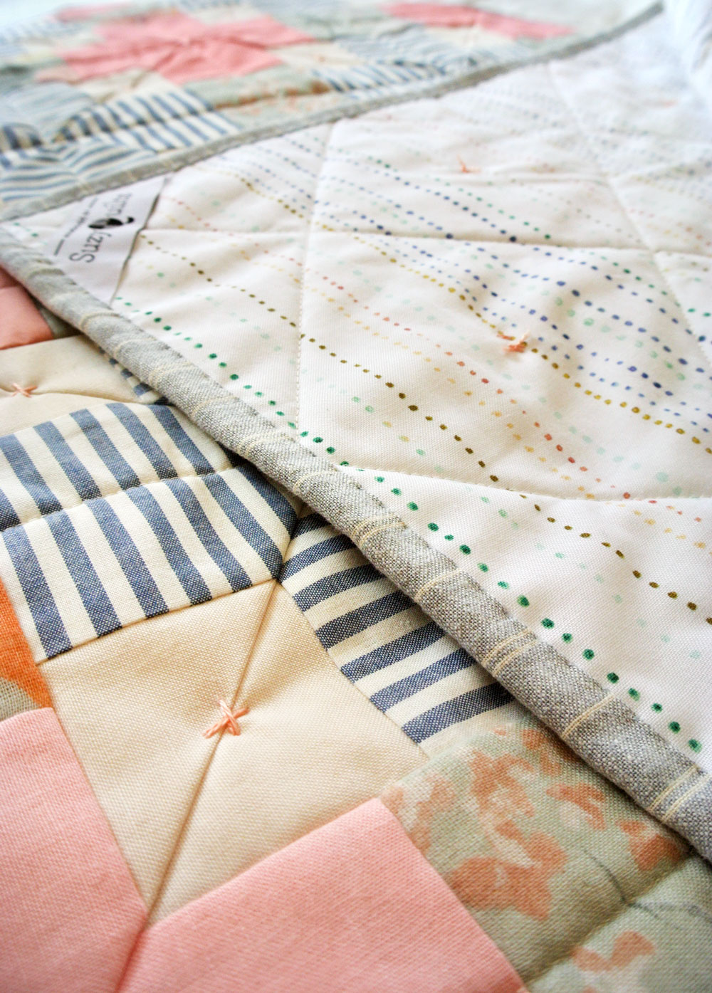 How to tie a quilt with a modern twist! | Suzy Quilts https://suzyquilts.com/how-to-tie-a-quilt-with-a-modern-twist