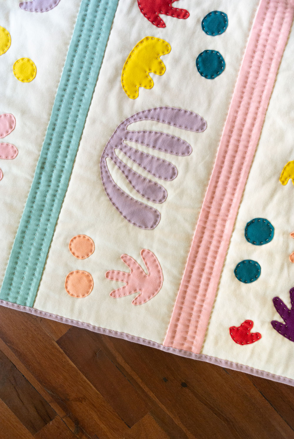 Hand sewing my jersey knit quilt. This Bohemian Garden quilt pattern was inspired by the paper cut-outs of Henri Matisse