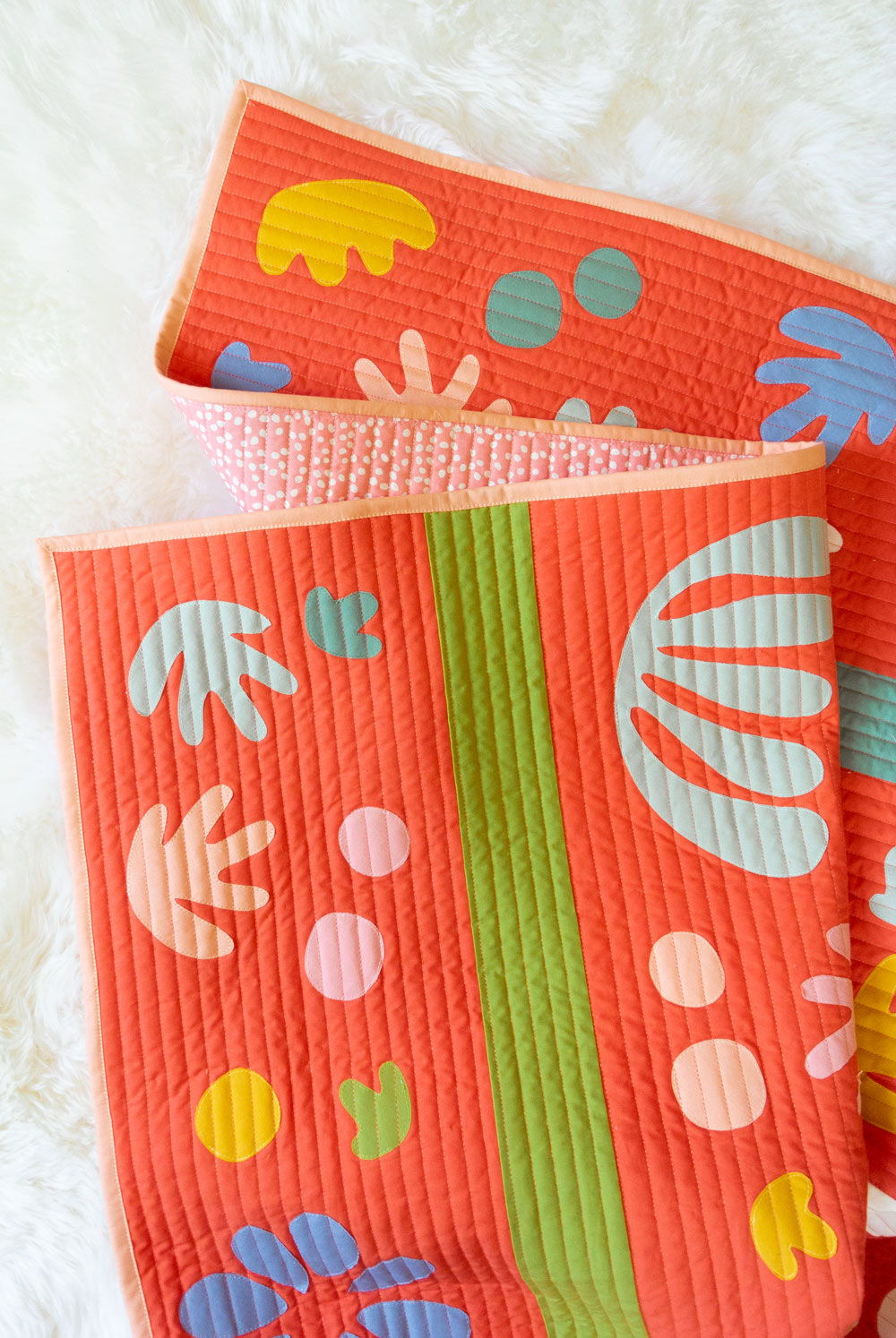 The Bohemian Garden quilt pattern includes a raw-edge applique step-by-step tutorial