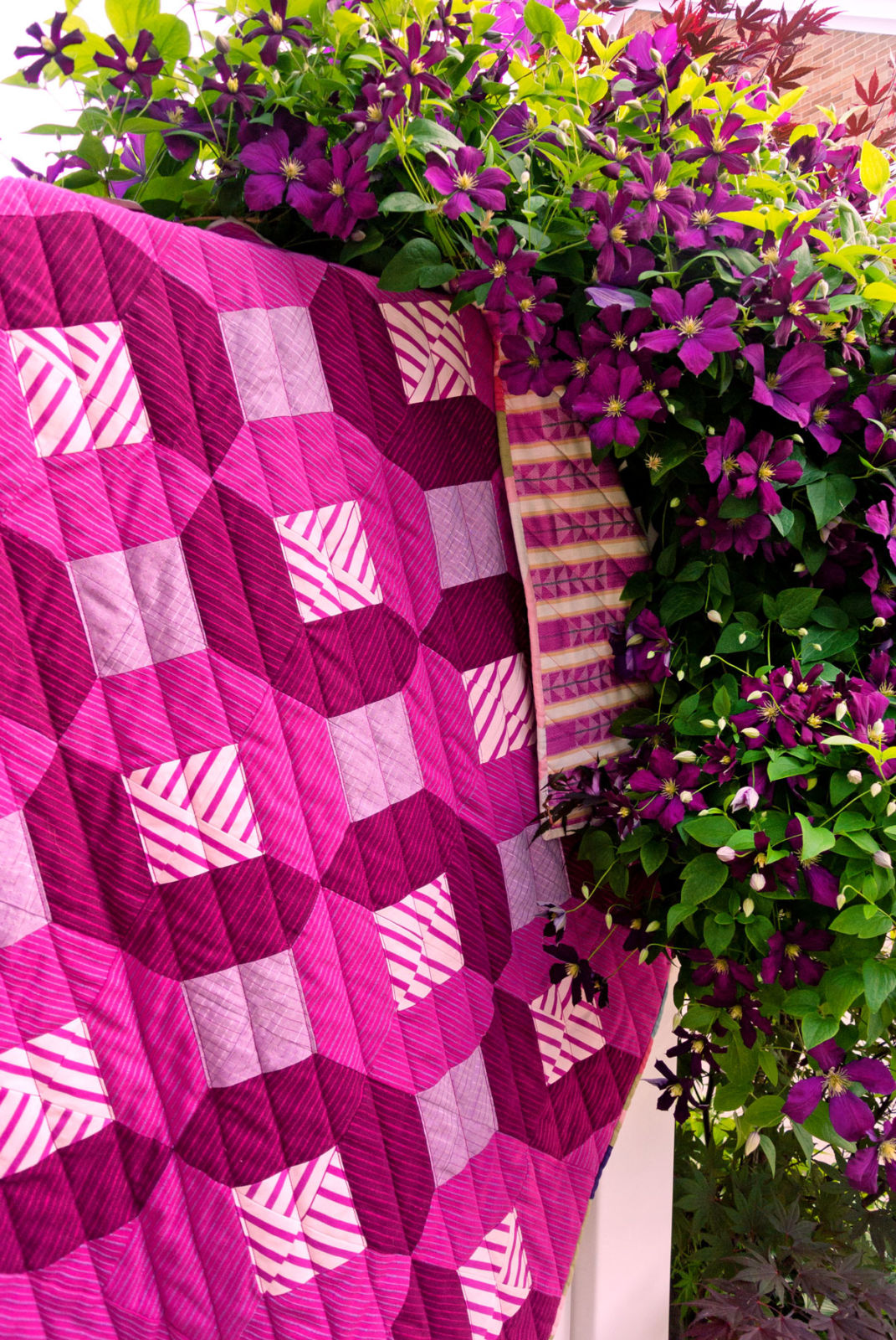 The Glitter & Glow quilt pattern is beginner friendly and also incredibly versatile. Use yardage, fat quarters or scraps! This baby quilt is rich in texture by incorporating Alison Glass mariner cloth