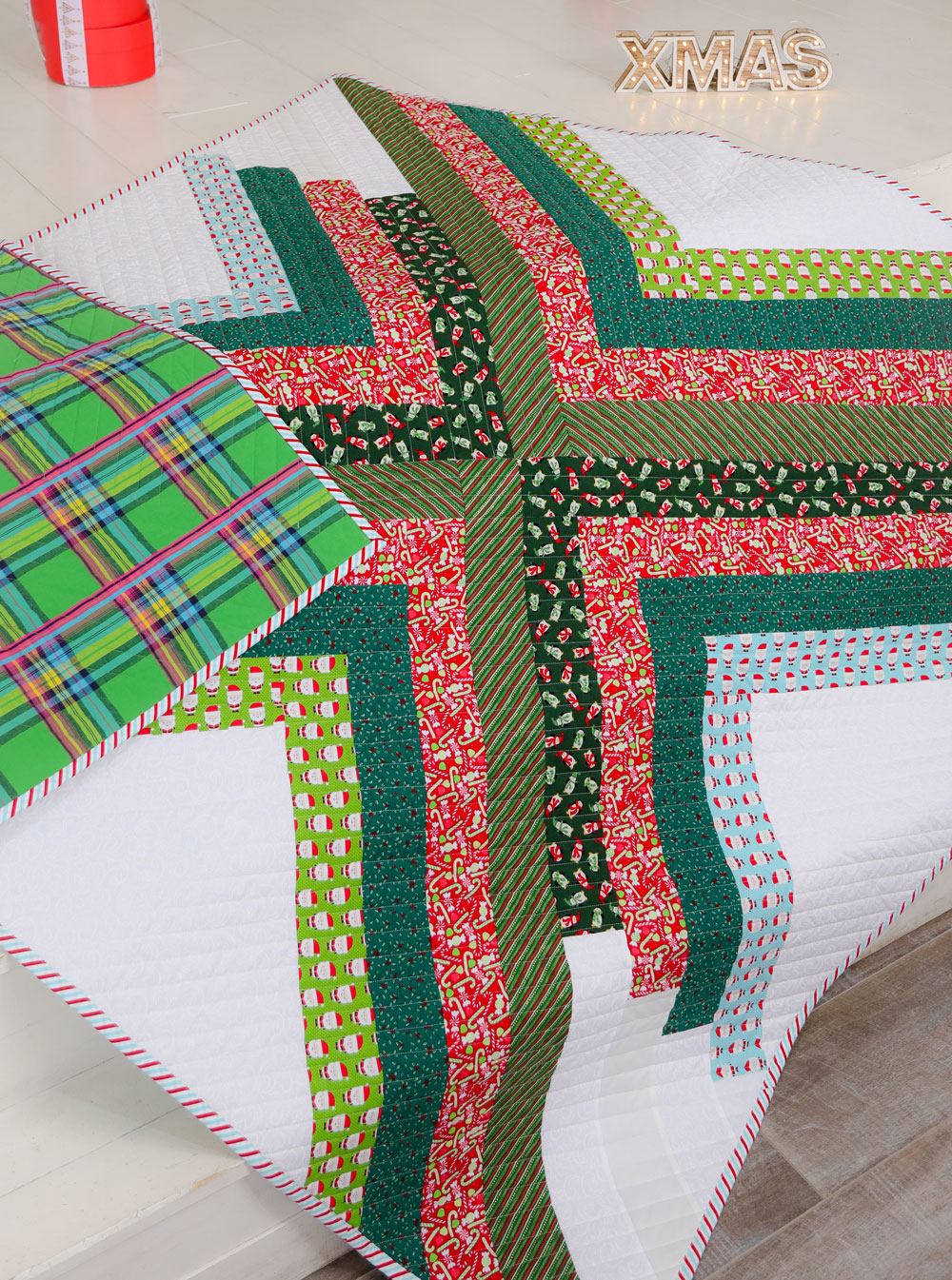 The Sugar POP quilt pattern is a PDF download that includes throw, baby and a pillow size. This modern design works well as a gradient or with fabric scraps. This pattern makes the perfect Christmas holiday quilt too!