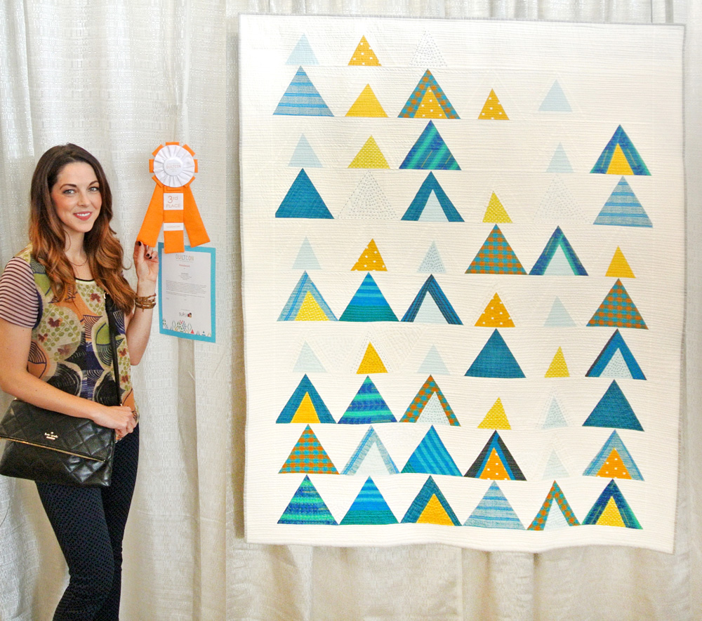 The Mod Mountains quilt pattern is fat quarter friendly and great for using fabric scraps from your stash. Video tutorials show step by step how to cut templates and sew triangles | Suzy Quilts - https://suzyquilts.com/mod-mountains-quilt-pattern-fabric-and-sewing-tips