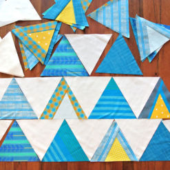 The Mod Mountains quilt pattern is fat quarter friendly and great for using fabric scraps from your stash. A video tutorial show step by step how to sew triangles. This quilt pattern includes fabric requirements for queen/full, twin, throw and baby quilt sizes.