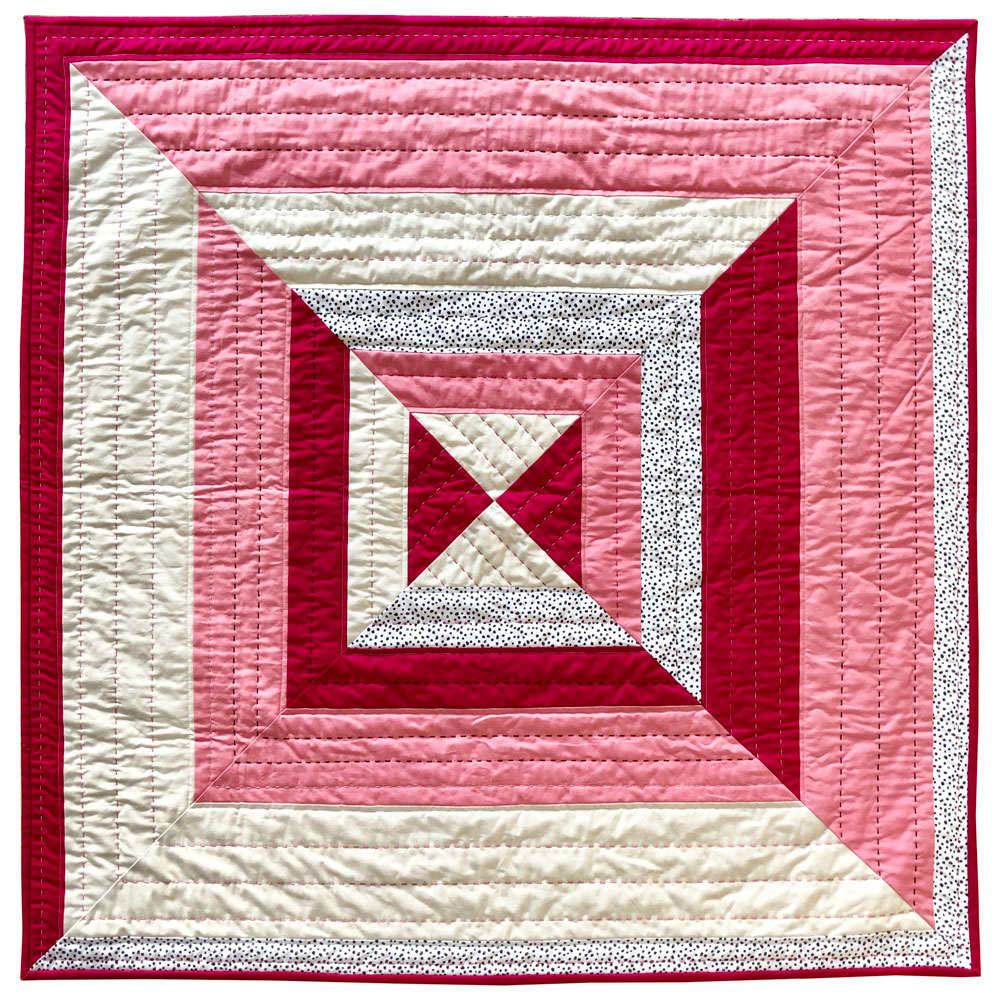 The Reflections quilt pattern is a beginner-friendly modern design that includes king, queen, full, twin, throw and baby quilt sizes.