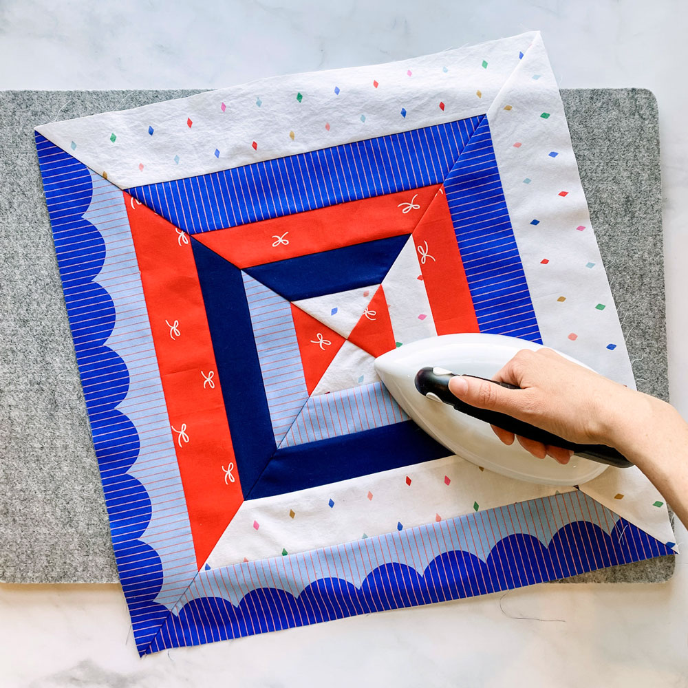 """The Reflections quilt pattern is a beginner-friendly modern design that includes king, queen, full, twin, throw and baby quilt sizes. The Extension pattern includes a 30"""" wall hanging and a 18"""" pillow."""