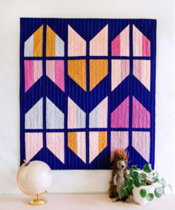 The Tail Feather Quilt Pattern is a modern quilt design that is fat quarter friendly! This PDF digital download includes queen, twin, throw and baby quilt sizes. A great beginner quilt pattern! SuzyQuilts.com