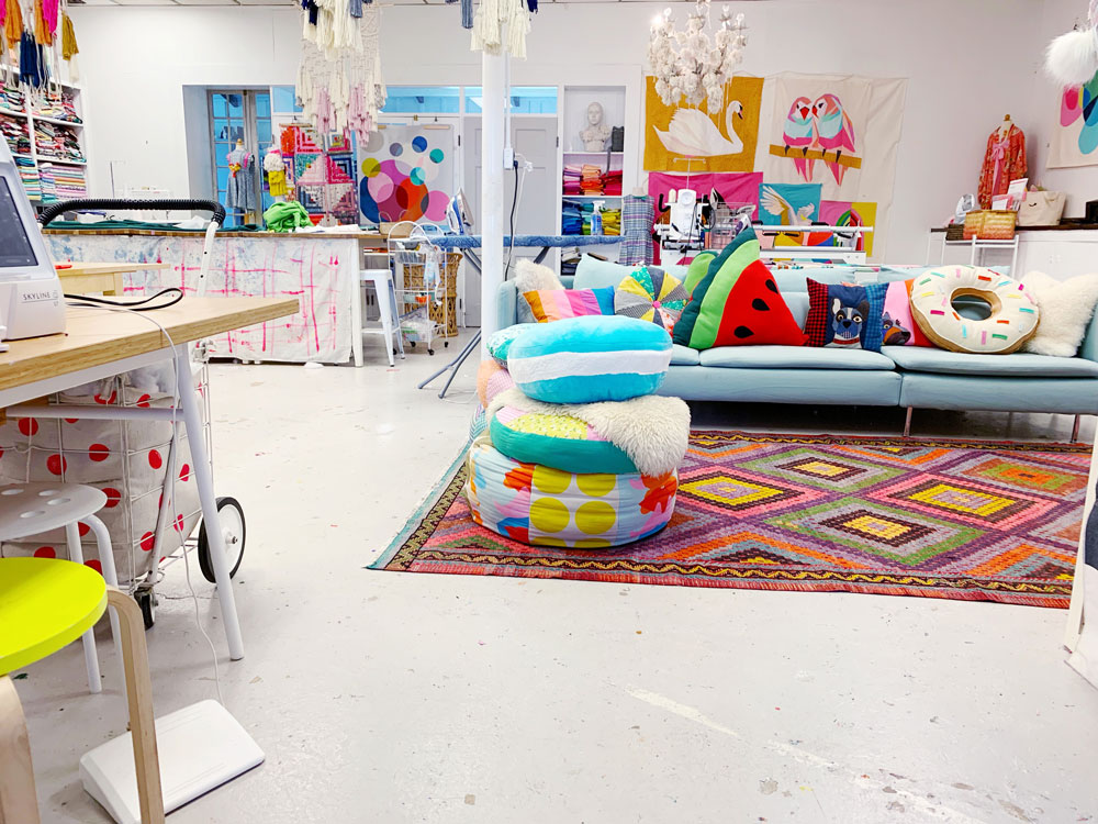 Annabel Wrigley is the founder of Little Pincushion Studio – a creative place that teaches sewing workshops to children as well as adults! Annabel is known for her colorful doodle quilts and bright fabric designs. suzyquilts.com #sewingclasses #kidsewing