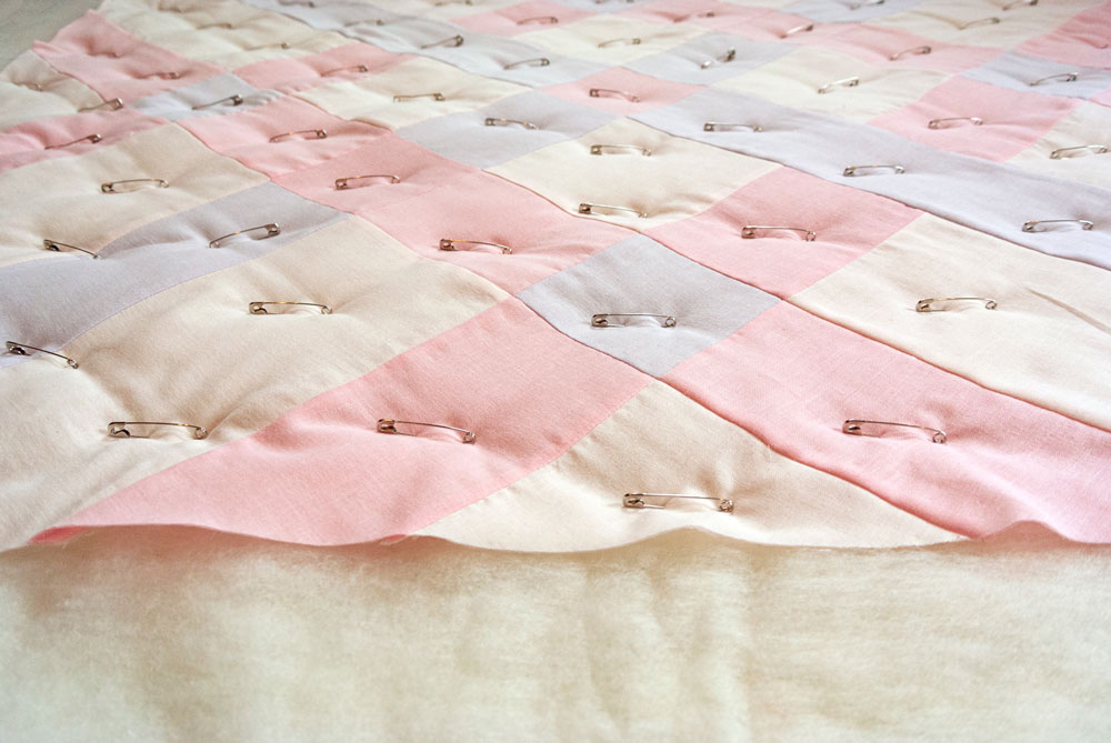 Why wool batting makes the warmest quilts! Learn how to quilt with this beautifully fluffy and sustainable fiber. suzyquilts.com #babyquilt #quilttutorial