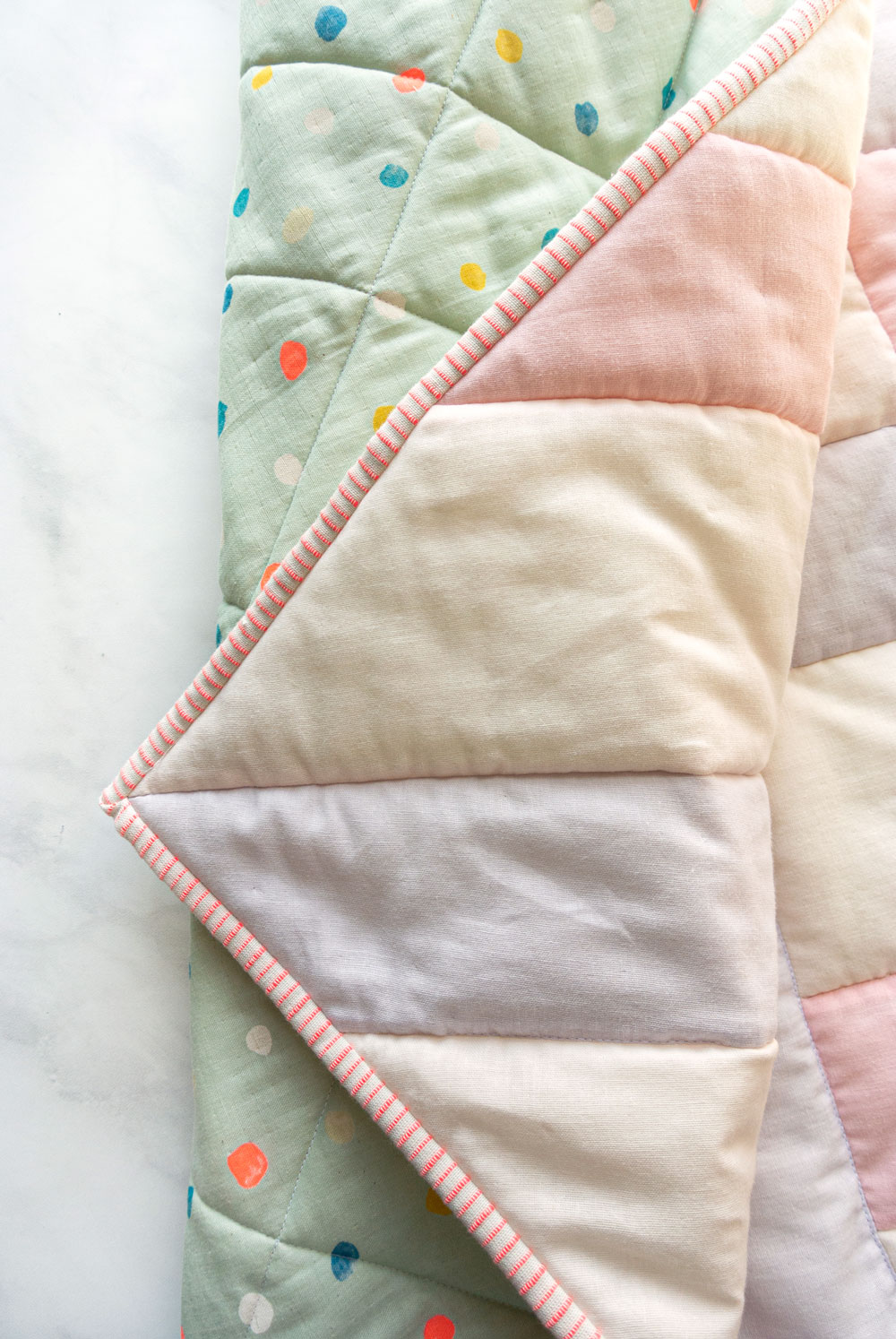 How to make the softest baby quilt in the world! The answer is to quilt with double gauze and wool batting – a sewing tutorial on how to do both! suzyquilts.com #babyquiltpattern #nurseryinspo