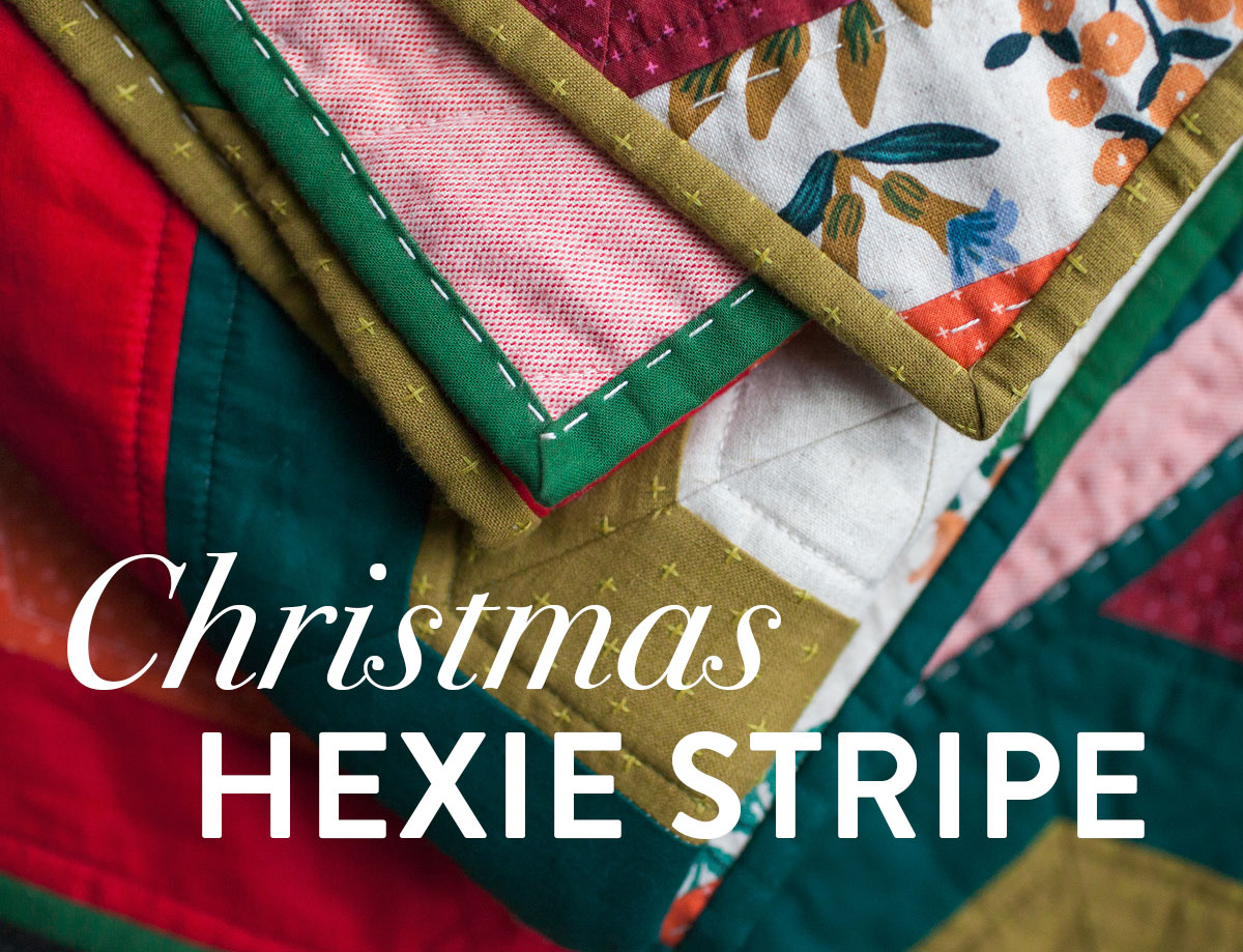 It's easy to get in the holiday spirit and get your Christmas quilting done with a pattern like Hexie Stripe. It's a vintage design with a modern twist! To make a throw all you need are 9 different 1/2 yd. cuts of fabric. Mix red and green solids with some floral prints for a beautifully festive quilt! suzyquilts.com #christmasquilt #christmassewing