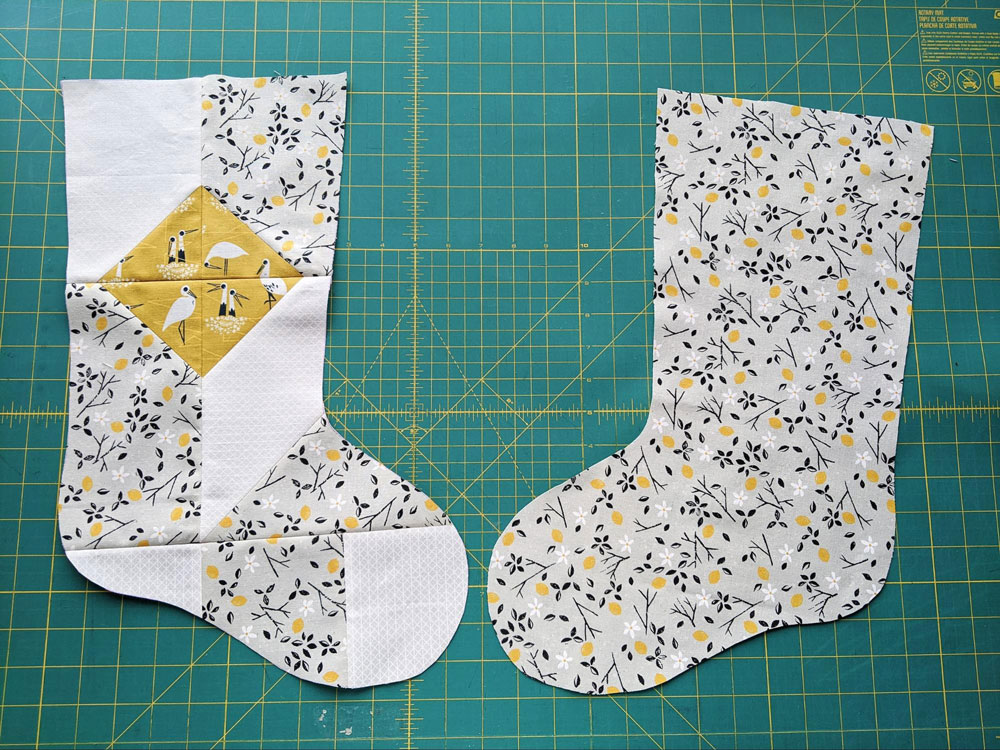 A free quilted Christmas stocking pattern right in time for the holidays! Sew a simple, modern stocking with this step by step tutorial. suzyquilts.com #DIYstocking #stockingtutorial