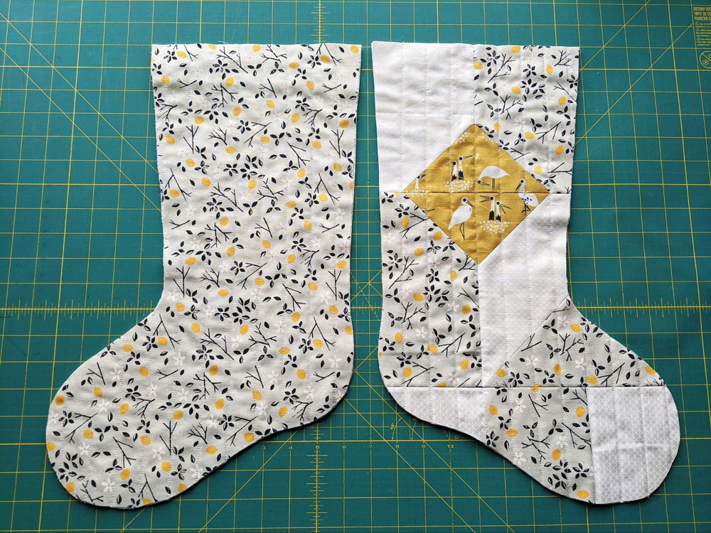 A free quilted Christmas stocking pattern right in time for the holidays! Sew a simple, modern stocking with this step by step tutorial. suzyquilts.com #DIYstocking #quiltedstocking