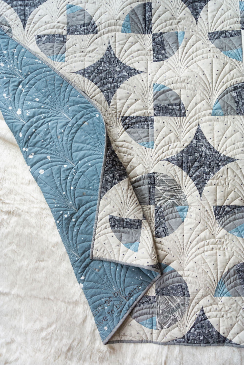 This Great Gatsby inspired Modern Fans quilt kit uses icy blues, grays and metallic silver fabric to bring elegance and pizzazz to a cozy quilt. suzyquilts.com #quiltpattern