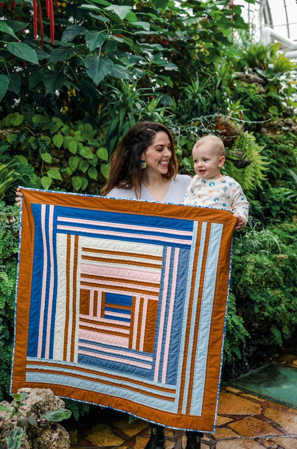 The Grow quilt pattern release March 12, 2020. It will include king, queen, twin, throw and baby quilt sizes. suzyquilts.com #modernbabyquilt