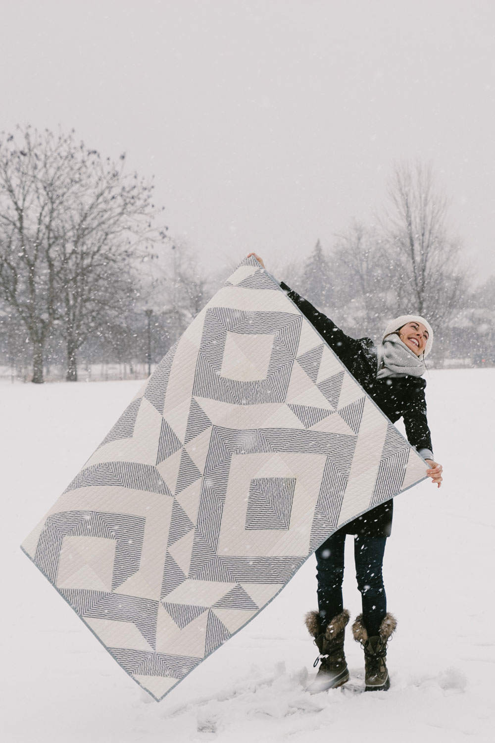 Elevate any quilt pattern to pure elegance by making it a two-fabric quilt. This neutral Triangle Jitters quilt uses cream scraps and a simple stripe. suzyquilts.com #modernquiltpattern