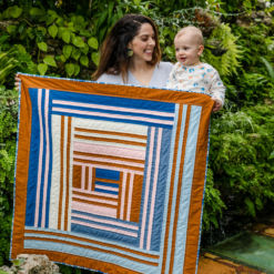 The Grow quilt pattern includes king, queen, twin, throw and baby quilt sizes. It is a modern interpretation of a traditional medallion quilt. suzyquilts.com
