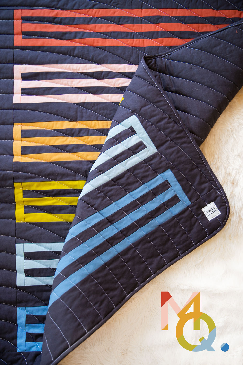 A small textiles company, based in Duluth, GA, makes rainbow baby quilts for a cause. Meesh Quilts is passionate about helping mothers and babies. suzyquilts.com #babyquilts