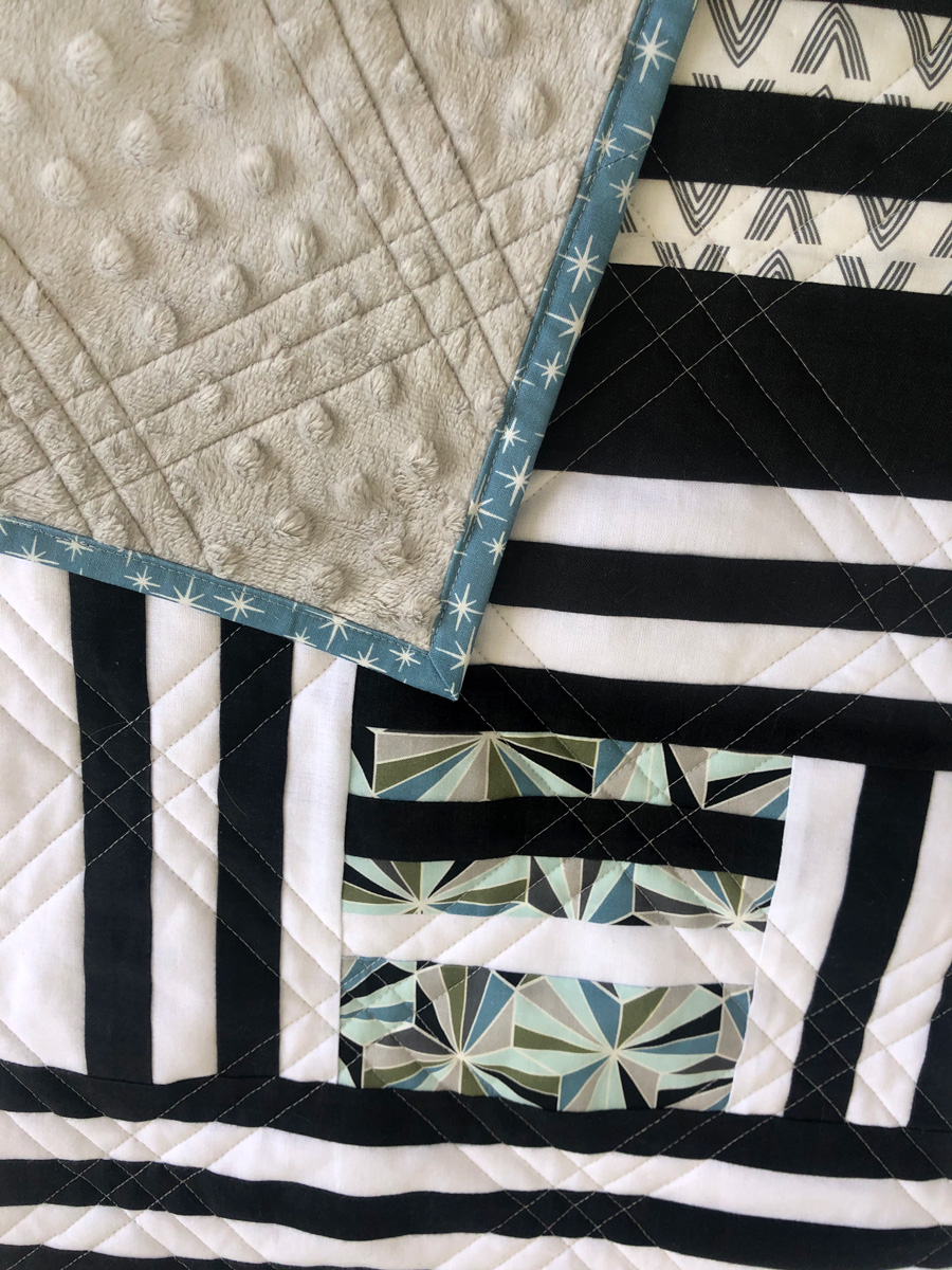 The Grow quilt pattern focuses on strip piecing – a simple quilting technique that creates a beautiful modern design. Beginner Friendly quilt pattern. See lots of quilt examples! suzyquilts.com #minkyquilt
