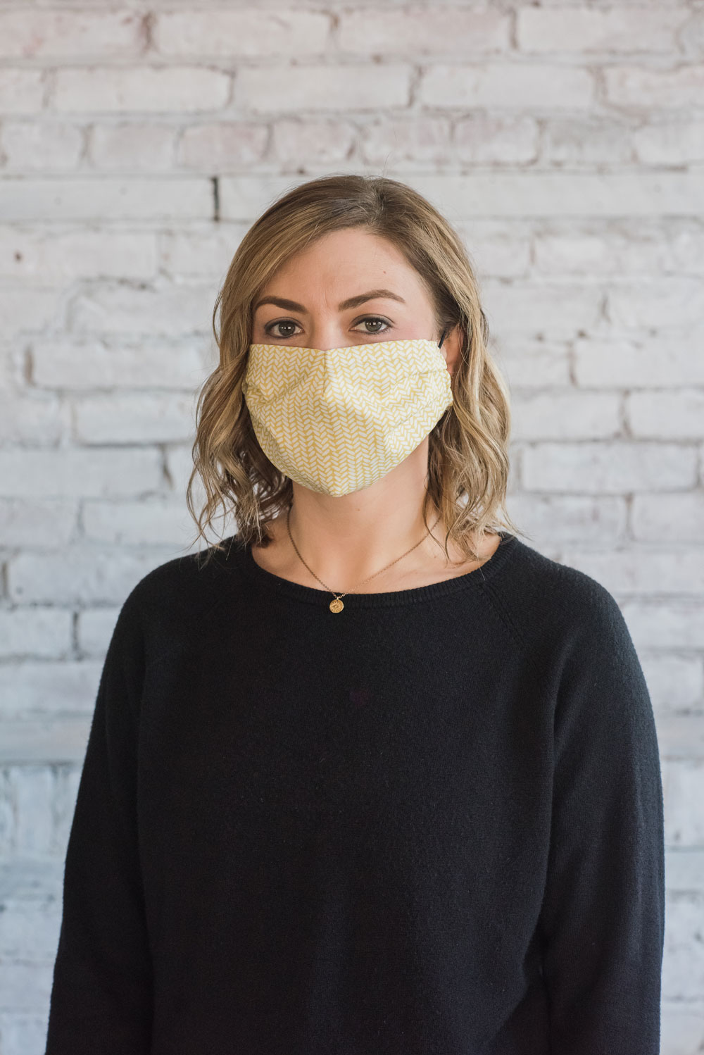 Our current global pandemic has created a shortage of medical masks. This free pattern with video explains how to sew a protective face mask with fabric. suzyquilts.com #facemaskpattern #sewfacemask