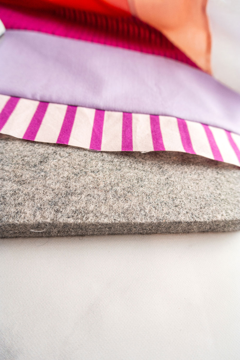 A wool pressing mat can be a wonderful tool in quilting. Portable, lightweight, and made of only natural fibers, these mats can also help iron fabric in half the time! suzyquilts.com #quilting #quilt #sewing