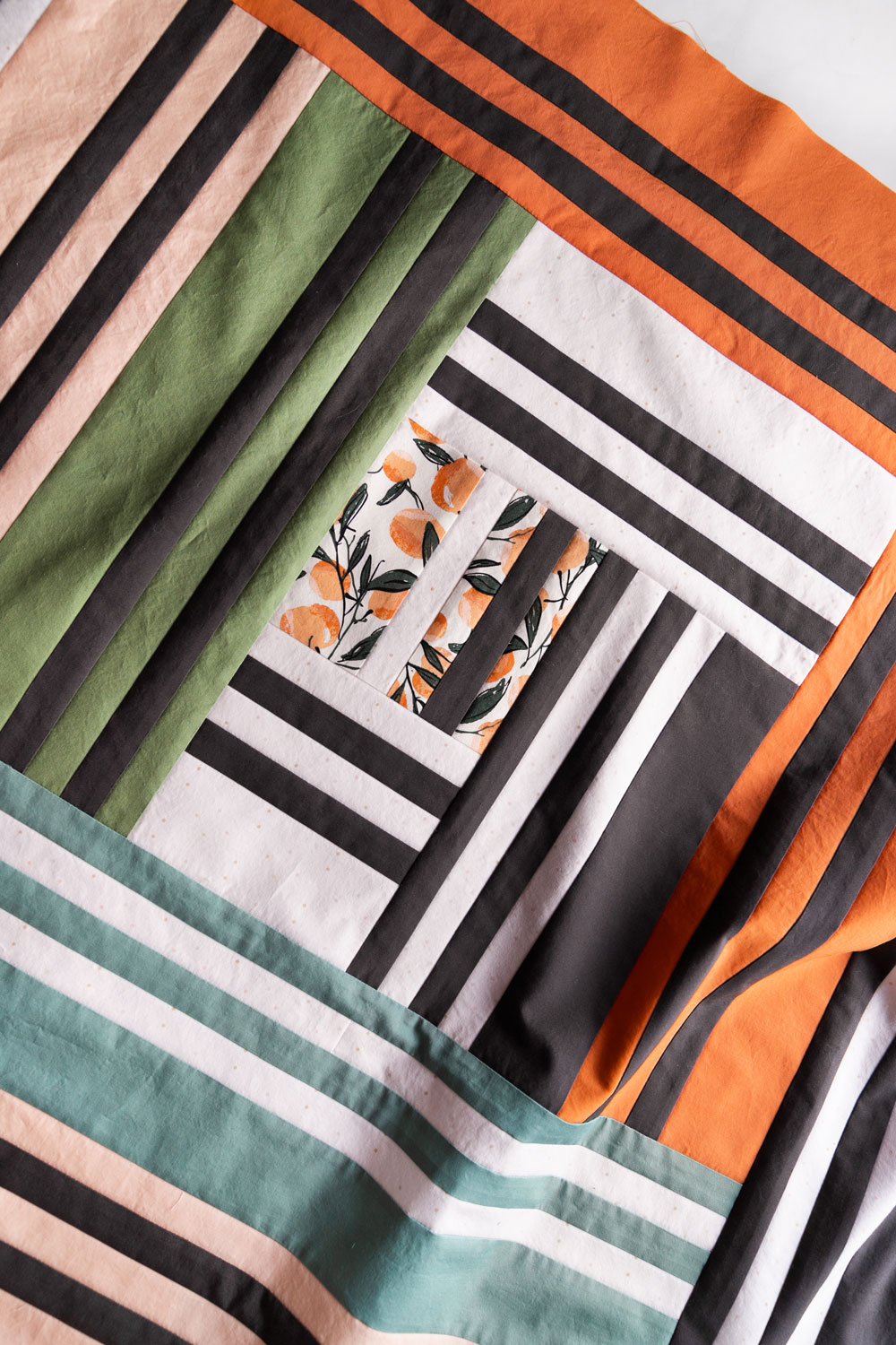 In Weeks 5 and 6 of the Grow quilt sew along we assemble the quilt top. Check out this video tutorial to show you how simple it is! suzyquilts.com #quilting #modernquiltpattern
