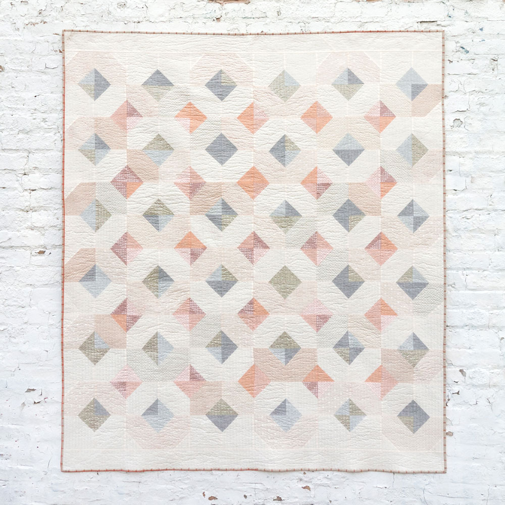 The Glitter & Glow Quilt Pattern Download is a great pattern for using up scraps or fat quarters. It comes in king, queen, twin, throw and baby quilt sizes. suzyquilts.com #quiltpattern