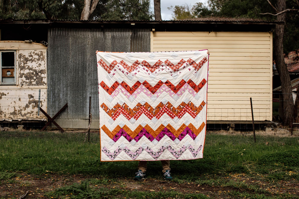 Thrive is a fat-quarter friendly modern quilt pattern using Ruby Star Society fabric. This instant PDF download comes in king, queen/full, twin, throw and baby quilt sizes. suzyquilts.com