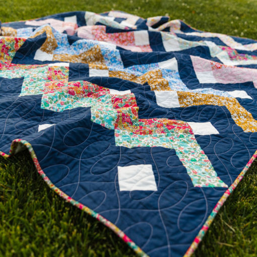 Thrive is a fat-quarter friendly modern quilt pattern using Liberty of London fabric. This instant PDF download comes in king, queen/full, twin, throw and baby quilt sizes. suzyquilts.com