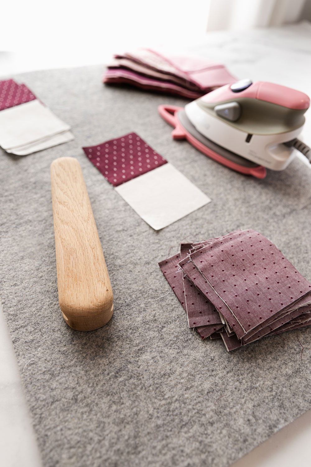 To get perfectly flat quilt blocks, press them with a wool pressing mat and a tailor's clapper | suzyquilts.com #quilting