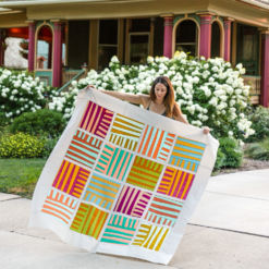 Shine is a modern quilt pattern that includes sizes for a king quilt, queen quilt, twin quilt, throw quilt, bay quilt and pillow. Each quilt block is made from simple improv sewing. The digital quilt pattern includes a video tutorial! suzyquilts.com