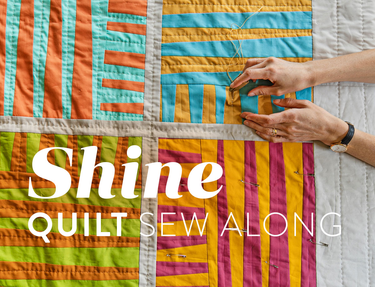 The Shine quilt sew along includes lots of added tips and videos to help you make this modern quilt pattern. This fat quarter quilt pattern is beginner friendly and focuses on improv sewing. suzyquilts.com #qal #quilting