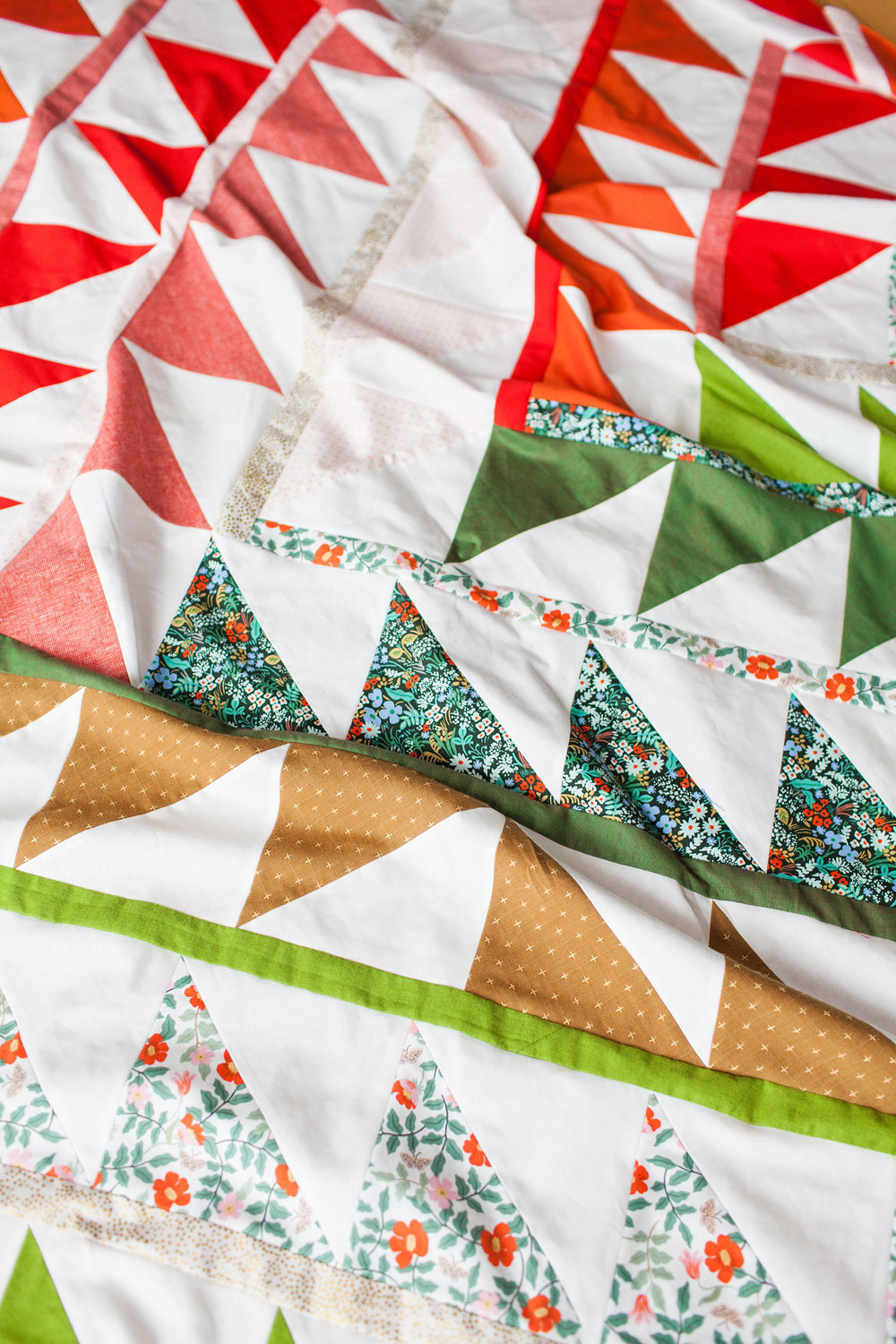Gather is an HST modern quilt pattern with a unique twist! This instant PDF download comes in queen, twin, throw and baby quilt sizes. suzyquilts.com #christmasquilt