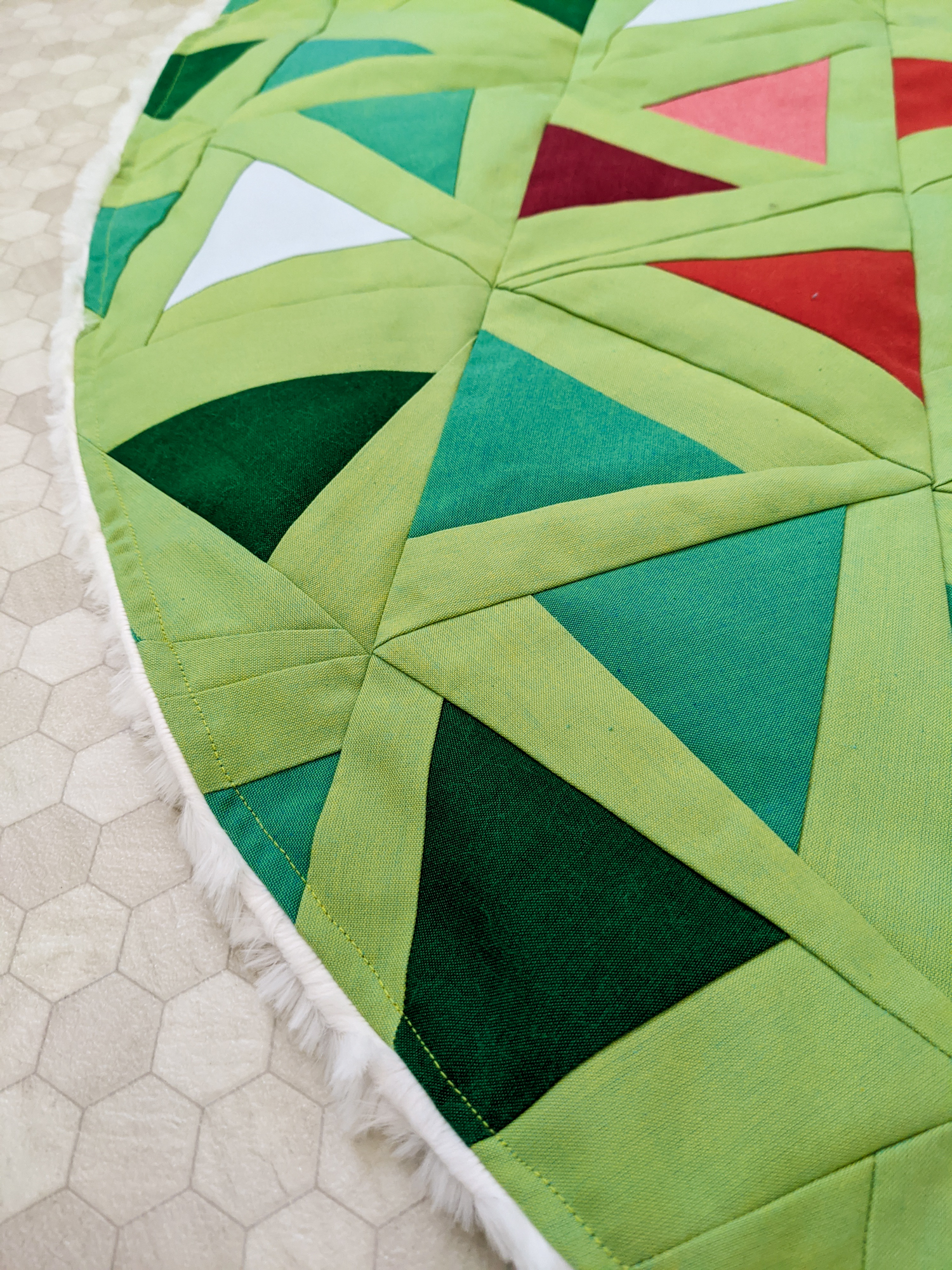 This DIY Patchwork Tree Skirt tutorial walks you through sewing a Christmas tree skirt based on the Perennial Quilt Pattern by Suzy Quilts