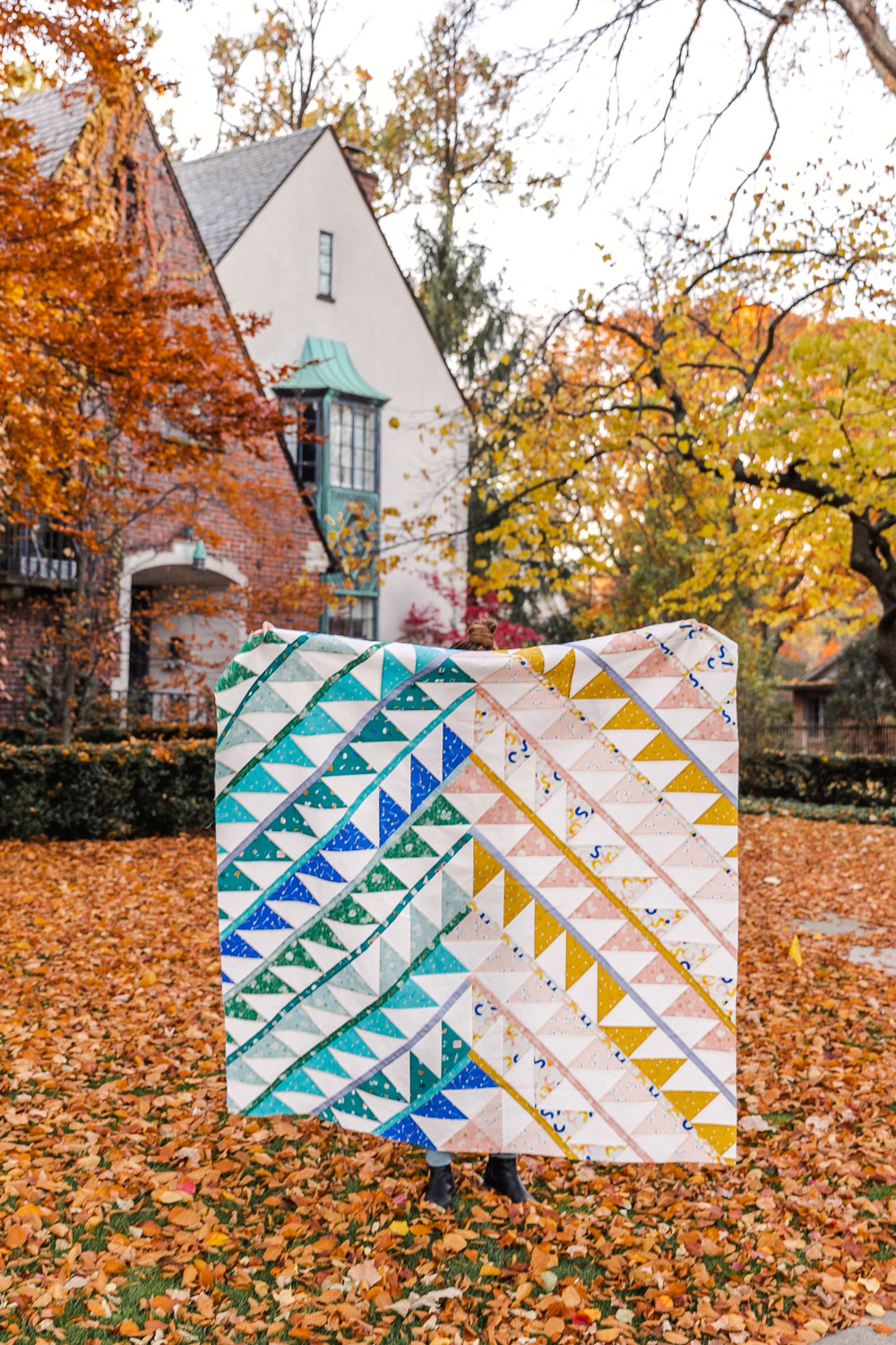 Gather is an HST modern quilt pattern with a unique twist! This instant PDF download comes in queen, twin, throw and baby quilt sizes. suzyquilts.com #quilthst