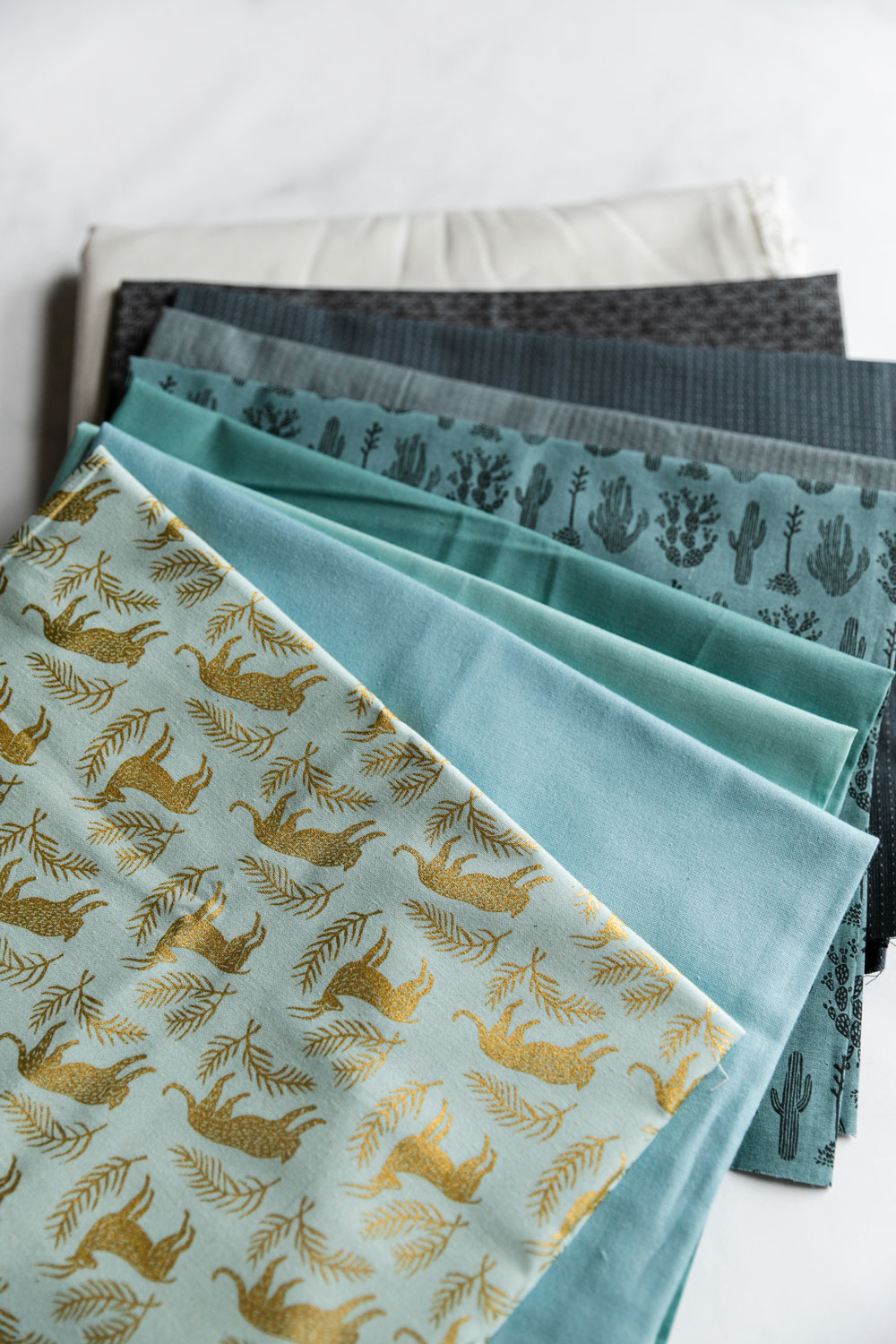 3 tips you need to know about best practices for fabric storage to prevent damage to your quilt fabric stash. Follow these simple steps to keep your quilt fabrics looking brand new! suzyquilts.com #quilting #fabric