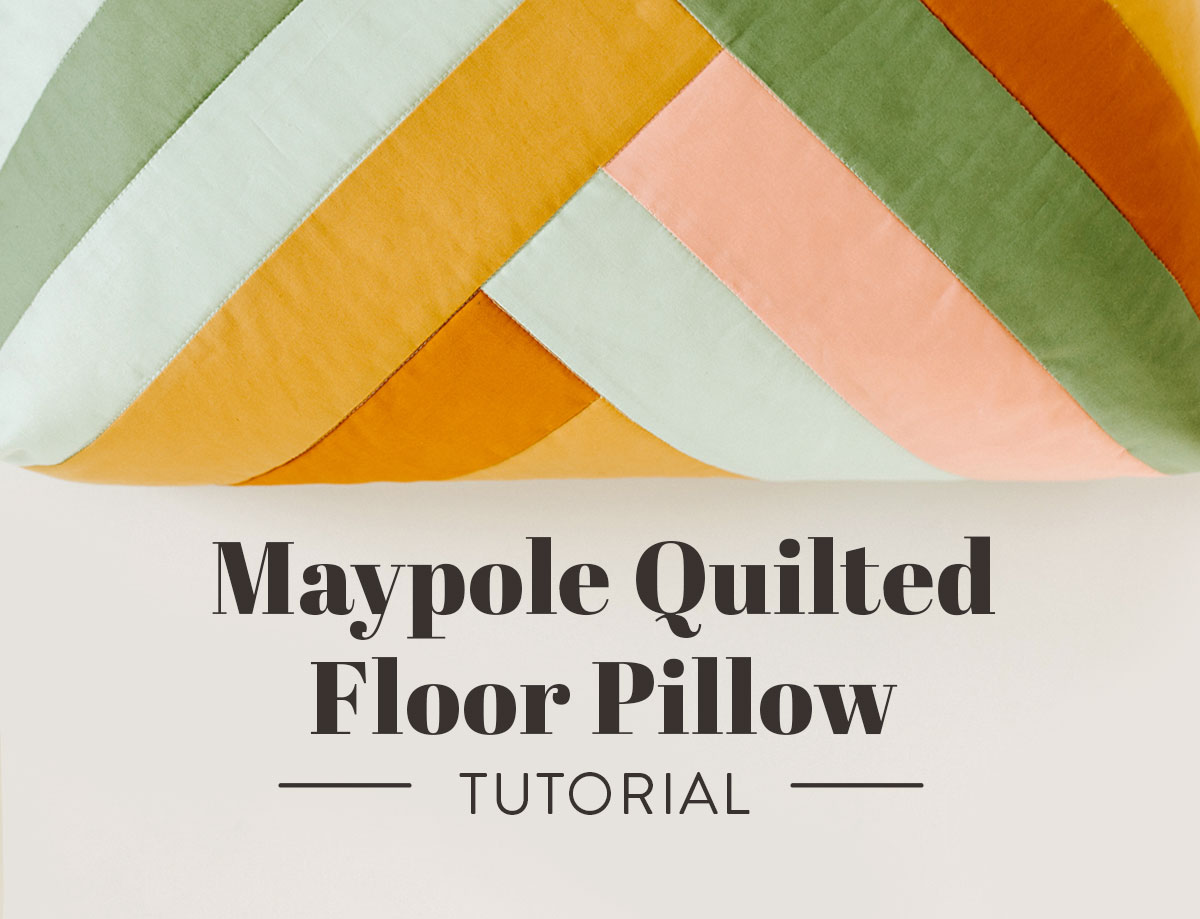 This quilted floor pillow tutorial walks you through step-by-step instructions to sew a floor pillow using the Maypole wall hanging pattern. suzyquilts.com #sewingtutorial #quiltpattern