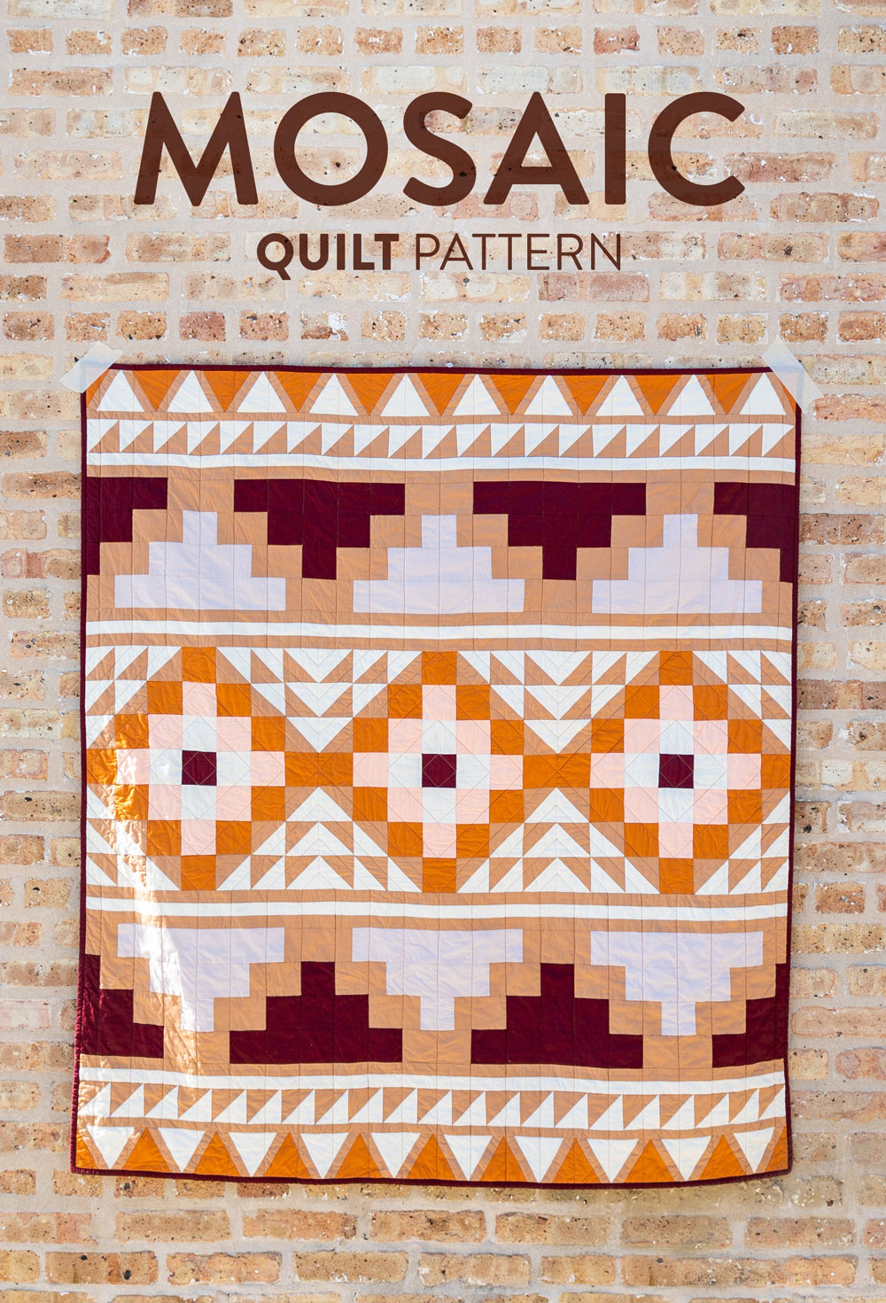 Be inspired by colors of the desert and make your own Mosaic quilt. With warm solid fabrics, this quilt pattern looks modern and timeless! suzyquilts.com #quiltkit #quiltpattern