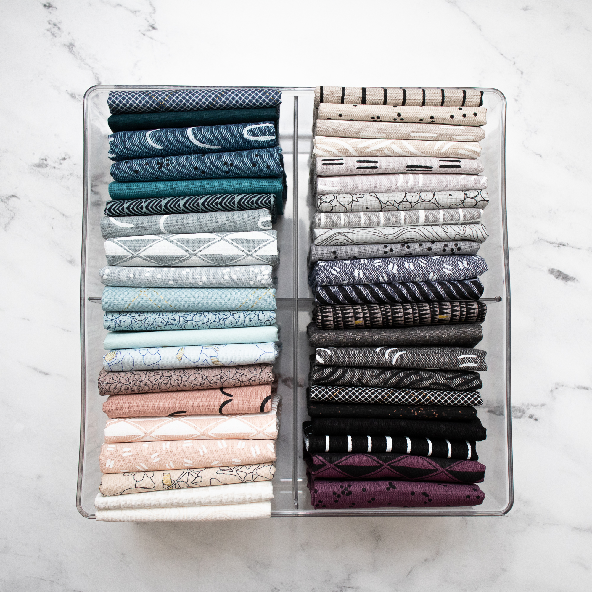 Simple steps for quilting fabric organization that can be easily adapted to your unique sewing room and fabric stash. Follow these steps with photo examples, links to resources and supplies, and tips to start organizing your fabric stash today. #suzyquilts #quilting suzyquilts.com
