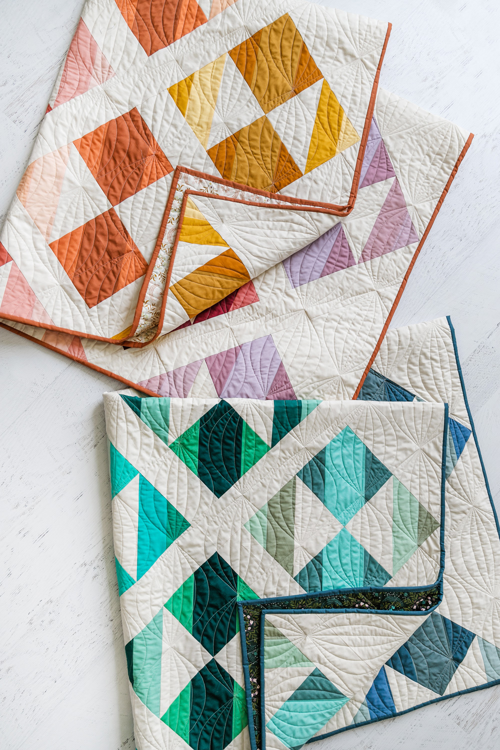 This modern ombre fat quarter quilt pattern is a good beginner quilt pattern and makes a beautiful scrap quilt. The sewing pattern also includes instructions for a limited-color version. suzyquilts.com #quiltpattern #modernquilt