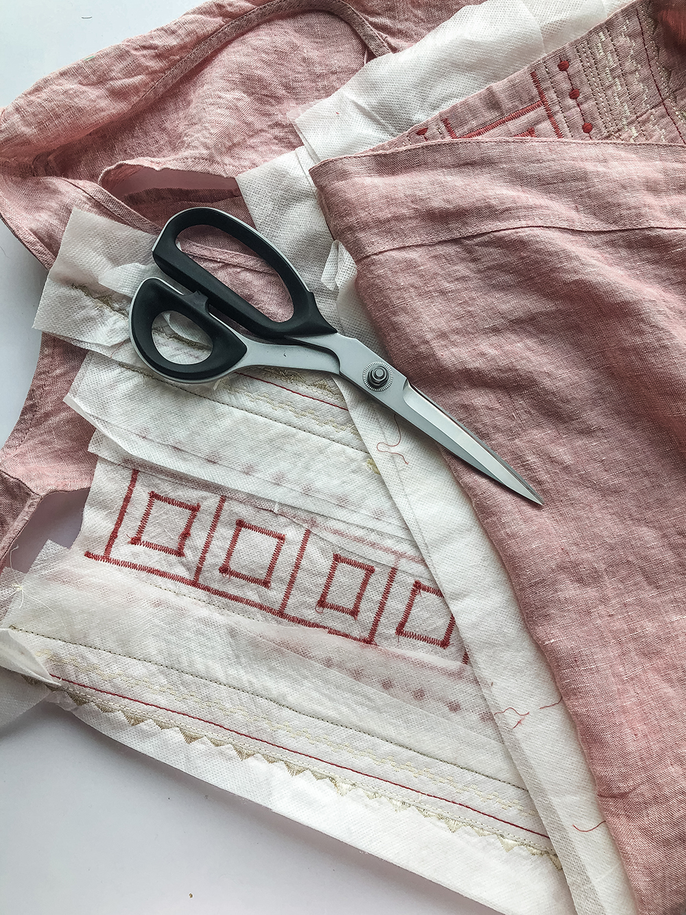 Spruce up your wardrobe by learning how to add decorative stitches to clothes! In this step by step tutorial, you'll learn the best locations on garments for decorative stitches, how to prep your garments for embellishment, and more tips for quilters who want to get the most out of their sewing machine stitches. suzyquilts.com #quilting #sewingdiy