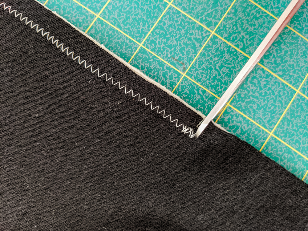 Sewing with knits doesn't have to be stressful! Read this informative post for tips and tricks about working with knits, and use whatyou learned to make your own Bohemian Garden shrug with step by step photos! suzyquilts.com #quilting #sewingdiy