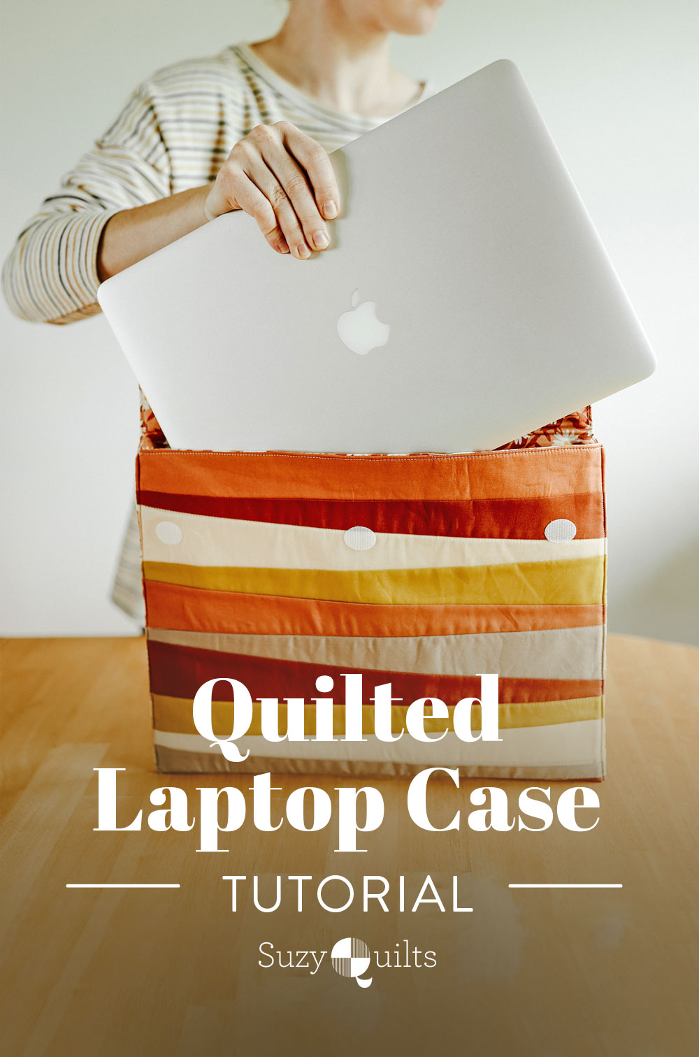Learn to sew a beginner-friendly quilted laptop case in this tutorial featuring the Shine quilt block by Suzy Quilts. suzyquilts.com #sewingdiy #quilting