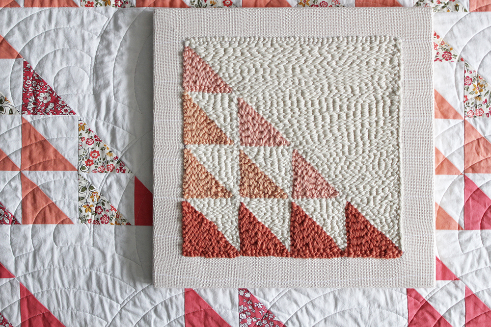 Turn a Suzy Quilts pattern into a punch needle masterpiece with this step by step tutorial! Learn a new fiber arts skill from scratch, and make a quilt block punch needle canvas to match your latest quilt. suzyquilts.com #quilting #sewingdiy