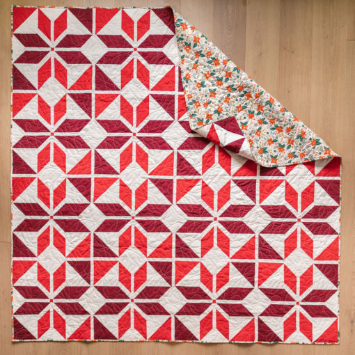 """Holiday Party quilt pattern kit. A festive red quilt kit for a throw, 77"""" x 77"""" quilt. suzyquilts.com"""