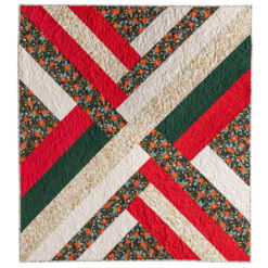 Classic Christmas fabric in a mixture of high quality solids and Rifle Paper Co prints to make a Maypole quilt. suzyquilts.com